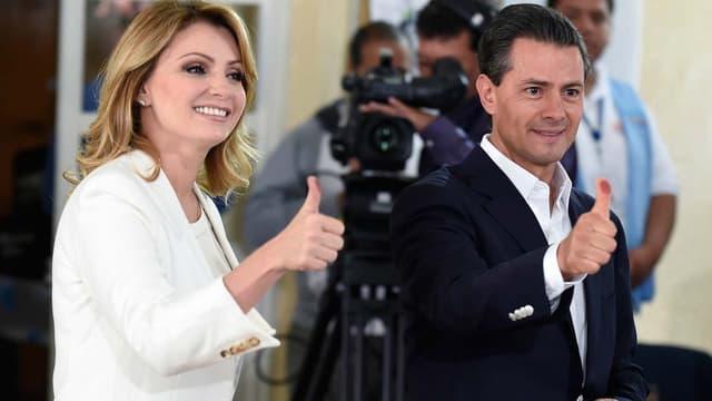 Le président Enrique Pena Nieto et son épouse à la sortie d'un bureau de vote à Mexico le 7 juin.