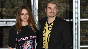 Stella McCartney pose avec l'acteur Orlando Bloom, venu voir sa première collection masculine à Londres, le 10 novembre 2016
