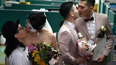 The first couples to marry embraced and kissed after receiving their marriage certificates