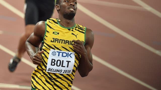 Usain Bolt n'a pas forcé pour se qualifier pour les demi-finales du 100 m à Pékin
