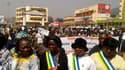 Manifestation de protestation vendredi dans les rues de Bangui encerclée par les rebelles de la Seleka. Les habitants de la capitale de la République centrafricaine ont commencé à faire des réserves ou à plier bagages, sur fond de grandes manoeuvres diplo