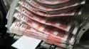 Les dotations de l'Etat aux collectivités locales pourraient baisser en 2014 et 2015 pour contribuer à la lutte contre les déficits si la croissance n'est pas au rendez-vous, a déclaré aux Echos la ministre de la Réforme de l'Etat et de la Fonction publiq