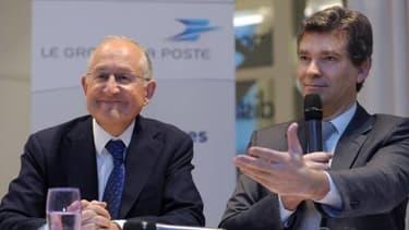Arnaud Montebourg (à droite), reçu par le patron de La Poste, Philippe Wahl (à gauche).