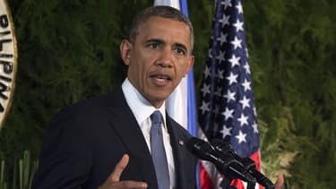 Barack Obama, ici lors d'un discours avec le président des Philippines, est actuellement à Manille, d'où il a fait communiquer les nouvelles sanctions contre la Russie.