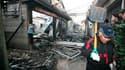 Maisons détruites après le bombardement nord-coréen sur l'île sud-coréenne de Yeonpyeong. Une intense activité diplomatique s'est développée mercredi pour tenter d'apaiser les tensions sur la péninsule coréenne au lendemain des tirs d'artillerie de la Cor