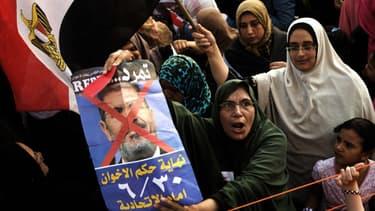 Des femmes participant à la manifestation qui a conduit à la destitution de Mohamed Morsi, le 3 juillet 2013.