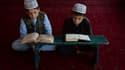 Enfants lisant le Coran.