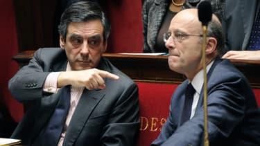 François Fillon et Alain Juppé, tous deux candidats à la primaire UMP, ici à l'Assemblée Nationale en 2011.