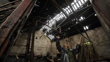 Maison endommagée par les violentes intempéries à Chongqing, dans le sud-ouest de la Chine. De fortes pluies accompagnées de vents violents ont fait au moins 39 morts et des centaines de blessés depuis mercredi soir dans le centre et le sud-ouest du pays.