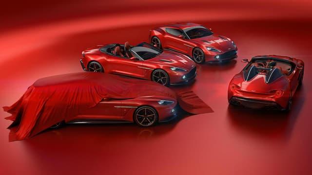 Aston Martin complète sa gamme de modèles inédits, conçus avec le carrossier italien Zagato. Sont désormais proposés un roadster et un break de chasse biplace (ici, camouflé sous une bâche).