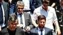Lionel Messi suivi de son père Jorge Messi