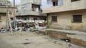 Dans un quartier de Homs. Le Croissant-Rouge syrien a commencé à évacuer vendredi des femmes et des enfants de Bab Amro, ce quartier de Homs soumis à d'intenses bombardements depuis trois semaines, tandis que la pression internationale s'est accentuée à l