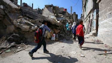 Le quartier de Set Zaynab, à Damas, est coutumier des explosions, comme ici le 13 octobre 2014.