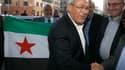 Le président du Conseil national syrien Bourhan Ghalioun à son arrivée à Rome, où trois jours de discussions sont prévus sur le renouvellement de l'équipe dirigeante du CNS, qui doit renforcer sa cohésion et assurer sa crédibilité. En Syrie, de violents a