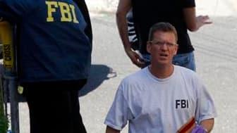 """Perquisition du FBI au domicile du suspect, Faisah Shahzad, à Bridgeport dans le Connecticut. L'existence de lien entre le suspect de l'attentat manqué de samedi soir à Times Square et les taliban pakistanais, qui l'ont revendiqué, est jugée """"entièrement"""