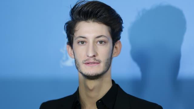 """L'acteur Pierre Niney à la projection de """"Yves Saint Laurent à Berlin en février 2014."""