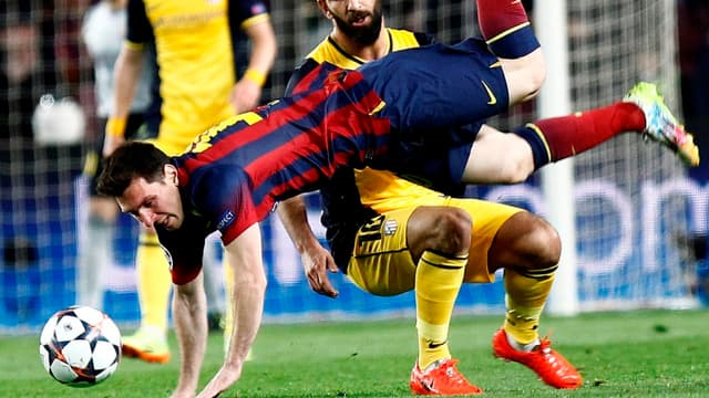 Lionel Messi et Arda Turan