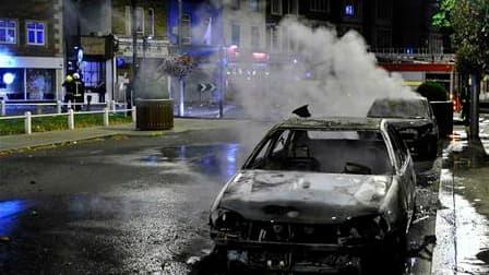 """Dans une rue du quartier d'Ealing, à Londres. Paris appelle ses ressortissants à faire preuve d'une """"extrême prudence"""" lors des sorties nocturnes en Grande-Bretagne, où les émeutes se sont étendues à d'autres villes d'Angleterre. """"Des actes de délinquance"""