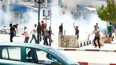 Des affrontements ont éclaté dimanche à Kairouan (photo) et Tunis entre la police et des salafistes protestant contre l'interdiction du rassemblement annuel de leur organisation, Ansar al Charia, dont le gouvernement islamiste modéré juge qu'elle représen