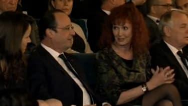 François Hollande aux côtés de Sabine Azéma, veuve d'Alain Resnais, le 10 mars 2014.