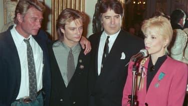 Johnny Hallyday, David Hallyday, Tony Scotti et Sylvie Vartan en 1987