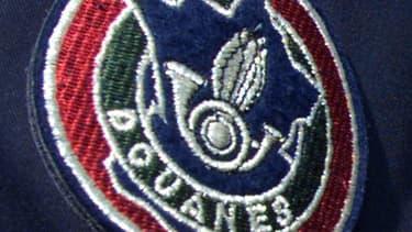 Sept douaniers en poste à l'aéroport de Roissy ont été mis en examen et écroués dans la nuit de samedi à dimanche pour avoir volé plusieurs millions d'euros provenant du trafic de drogue qu'ils étaient chargés d'intercepter. /Photo d'archives/REUTERS