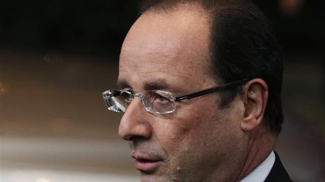 """François Hollande s'est prononcé jeudi en faveur d'une réforme de la participation et de l'intéressement des salariés, qui pourrait voir le jour """"dans quelques mois"""". /Photo prise le 22 novembre 2012/REUTERS/Sebastien Pirlet"""