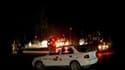 Sur les lieux d'un attentat à la bombe samedi à Kandahar, en l'Afghanistan. Les taliban ont revendiqué la responsabilité d'une série d'attentats suicides qui ont fait au moins 30 morts dans la ville du sud du pays. /Image tournée le 13 mars 2010/REUTERS/R