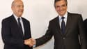 Poignée de mains officielle entre Alain Juppé et François Fillon dimanche soir au siège de la Haute autorité.