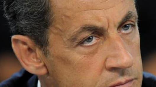 Nicolas Sarkozy a félicité jeudi les forces de l'ordre qui ont mis fin à Toulouse à la saga meurtrière du tueur au scooter et il s'exprimera à 13h00 en direct de l'Elysée à la radio et à la télévision. /Photo d'archives/REUTERS/Philippe Wojazer