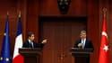 De Turquie où il s'est entretenu avec son homologue Abdullah Gül (à droite), Nicolas Sarkozy a réclamé le départ du dirigeant libyen Mouammar Kadhafi, confronté à un soulèvement populaire et dont le régime a violemment réprimé la contestation. /Photo pris