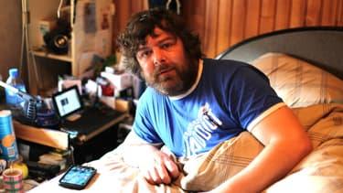 Jean-Christophe, le 14 mars dernier, dans son lit, où il passe la majeure partie de son temps.