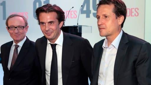 Les dirigeants de Canal Plus Bertand Meheut et Rodolphe Belmer entourant Yannick Bolloré.