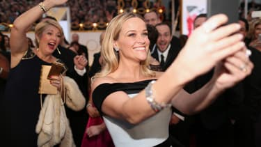 Reese Witherspoon sur le tapis rouge des Oscars 2015.