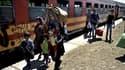 Des réfugiés syriens à leur arrivée dimanche dans le village de Tabanovce, en Macédoine.