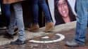 Le meurtre de la jeune joggeuse Marie-Jeanne Meyer, en juin 2011, avait suscité une très vive émotion. Ici un de ses portraits, le jour de ses obsèques.