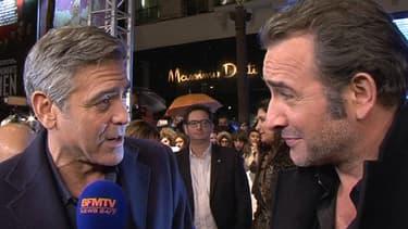 """George Clooney et Jean Dujardin lors de l'avant-première parisienne de """"Monuments Men"""", le 12 février 2014."""