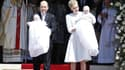 Les jumeaux princiers dans les bras de leurs parents, Albert et Charlène de Monaco.