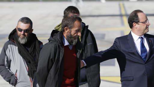Le 30 octobre 2013, François Hollande accueillait Marc Feret et Pierre Legrand, kidnappés en 2010 au Niger.