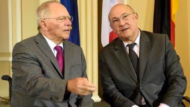 Wolfgang Schäuble ( à gauche) et Michel Sapin ( à droite) ce lundi 7 avril.