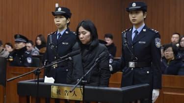 Mo Huanjing lors de son procès.