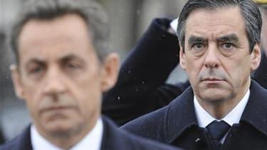 La popularité de Nicolas Sarkozy et de François Fillon se redresse légèrement mais reste proche de ses plus bas historiques, montre un sondage Harris Interactive publié dimanche par Le Parisien. /Photo d'archives/REUTERS/Miguel Medina/Pool