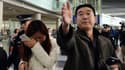 Des proches des passagers portés disparus, samedi, à Pékin.