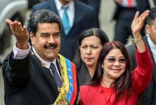 Le président vénézuélien Nicolas Maduro (G) et son épouse Cilia Flores, le 15 janvier 2017 à Caracas