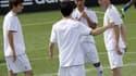 La famille Zidane au Real Madrid en 2011 : Enzo (à gauche) et Zinedine (à droite)