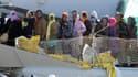 Un bateau transportant des migrants arrive au port de Messine, en Sicile, après une opération de sauvetage, le 18 avril 2015. (Illustration)