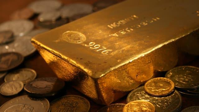 Lingot et pièces d'or. (illustration)