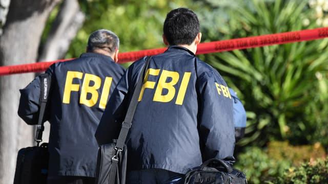 Des agents du FBI sur une scène de crime. (IMAGE D'ILLUSTRATION)