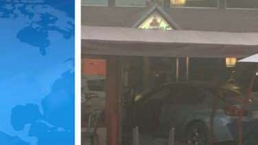La voiture encastrée dans la pizzeria.