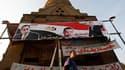 Affiches électorales du Parti national démocrate dans les rues du Caire, en novembre dernier. La justice égyptienne a ordonné samedi la dissolution du PND, l'ancienne formation politique du président déchu Hosni Moubarak. /Photo d'archives/REUTERS/Amr Abd
